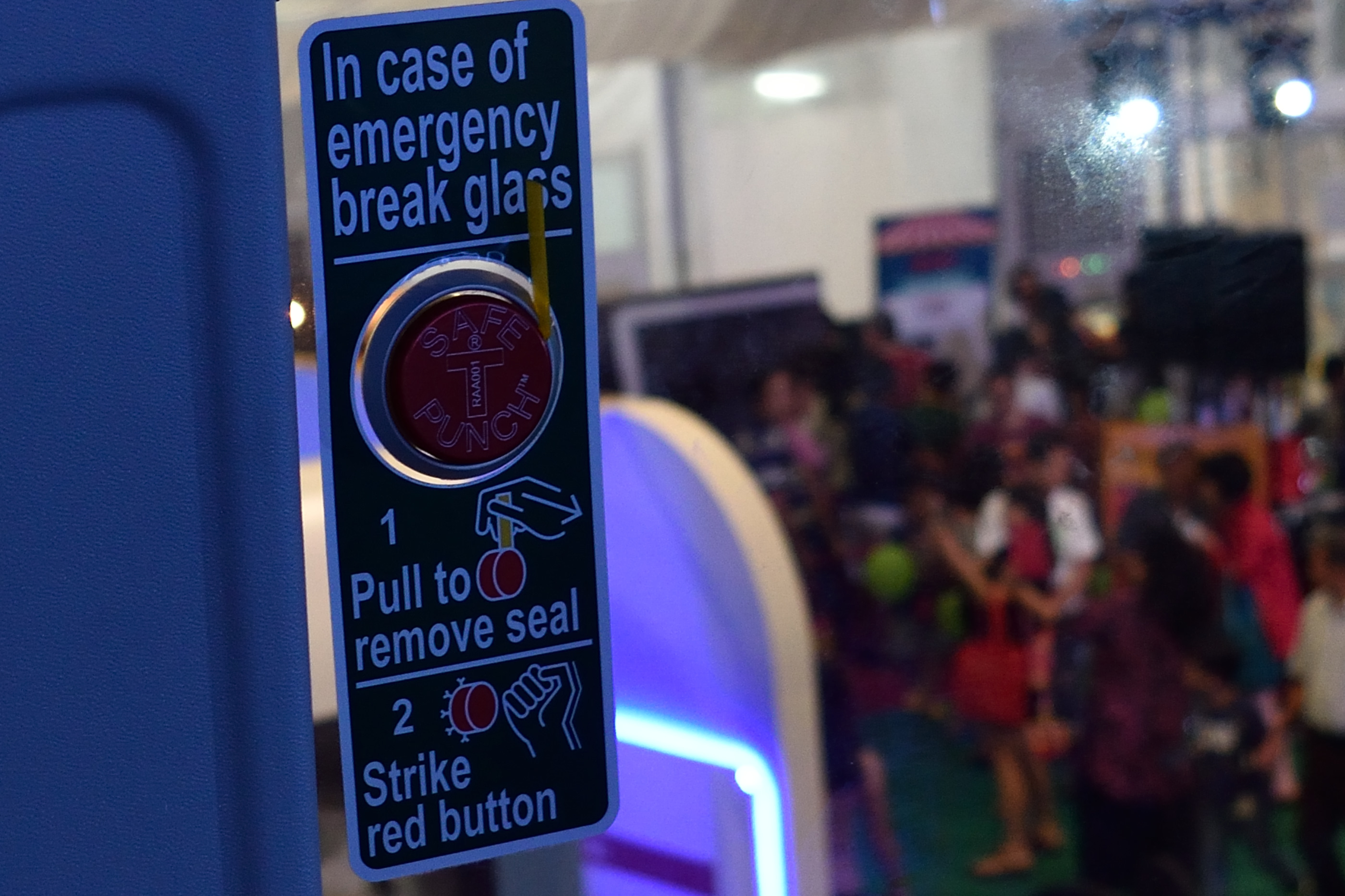 Push button to break glass.